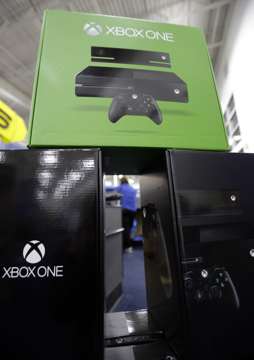 The Xbox One is on display at a Best Buy store on Friday, Nov. 22, 2013., in Evanston, Ill.  Microsoft is billing the Xbox One, which includes an updated Kinect motion sensor, as an all-in-one entertainment system rather than just a gaming console.  (AP Photo/Nam Y. Huh)