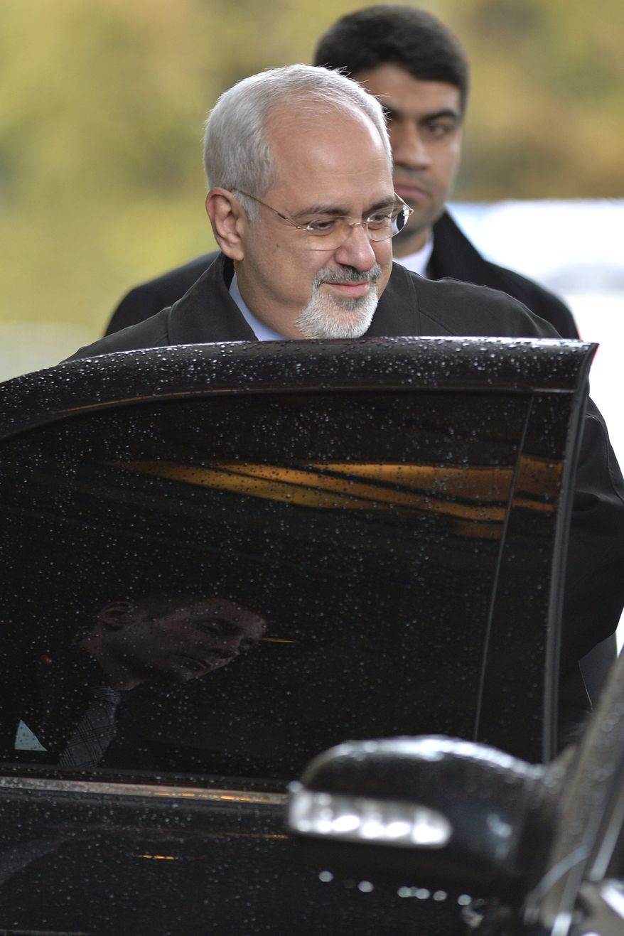 Iranian Foreign Minister Mohammad Javad Zarif leaves the hotel,  after  talks on Iran's nuclear program in Geneva Switzerland, Friday, Nov.22, 2013. Differences on whether Iran has the right to enrich uranium that could be used to make nuclear weapons appeared to be a key sticking point Friday between two top negotiators trying to agree on terms that would start curbing Tehran's atomic activities in exchange for sanctions relief. Iranian Foreign Minister Mohammad Javad Zarif and Catherine Ashton, the European Union's top diplomat, have met repeatedly since Wednesday to hammer out language on a nuclear deal acceptable to both Tehran and six world powers trying to limit Iran's nuclear program.  (AP Photo/Keystone,Martial Trezzini)