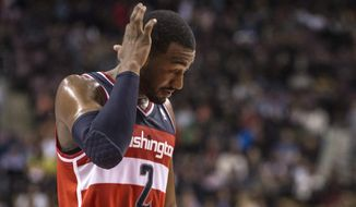 Washington Wizards' John Wall reacts during the first half of an NBA basketball game against the Toronto Raptors in Toronto on Friday, Nov. 22, 2013. (AP Photo/The Canadian Press, Chris Young)