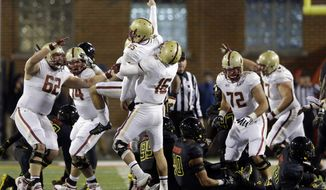 Boston College kicker Nate Freese (85) celebrates with teammates after kicking the game-winning field goal in the final moments of an NCAA college football game against Maryland in College Park, Md., Saturday, Nov. 23, 2013. Boston College won 29-26. (AP Photo/Patrick Semansky)