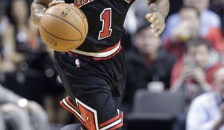Chicago Bulls guard Derrick Rose is shown during the second half of an NBA basketball game against the Portland Trail Blazers in Portland, Ore., Friday, Nov. 22, 2013.  Rose injured his right knee late in the third quarter and left the game. (AP Photo/Don Ryan)