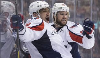 Washington Capitals' Alex Ovechkin, left, celebrates his goal with teammate Mike Green during third period NHL hockey action against the Toronto Maple Leafs in Toronto, Saturday, Nov. 23, 2013. Toronto won 2-1. (AP Photo/The Canadian Press, Chris Young)