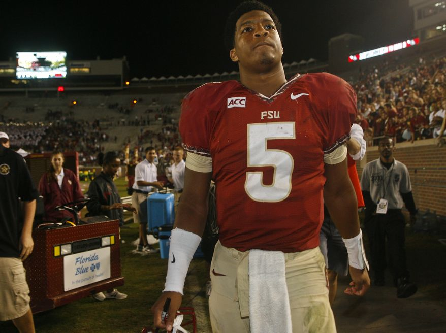 Florida State quarterback Jameis Winston (5) walks off the field after an NCAA college football game against Idaho on Saturday, Nov. 23, 2013 in Tallahassee, Fla. Florida State beat Idaho 80-14. (AP Photo/Phil Sears)