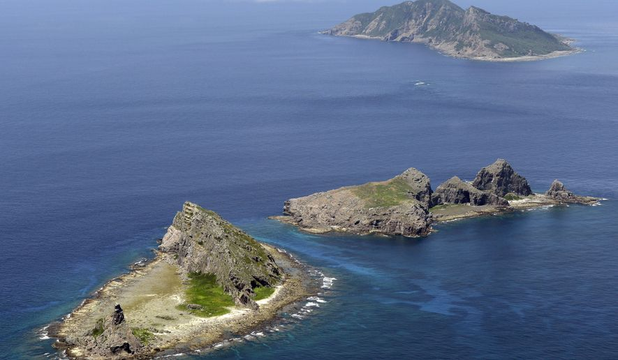 In this photo from September 2012, the tiny islands in the East China Sea, called Senkaku in Japanese and Diaoyu in Chinese, are seen. The Chinese Defense Ministry on Nov. 23, 2013, issued a map of an East China Sea Air Defense Identification Zone that includes a chain of disputed islands also claimed by Japan, triggering a protest from Tokyo. (Associated Press/Kyodo News)