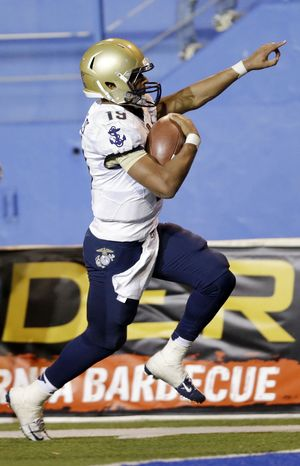 Navy quarterback Keenan Reynolds celebrates as he score the game-winning touchdown in  triple overtime for a 58-52 win over San Jose State in an NCAA college football game on Friday, Nov. 22, 2013, in San Jose, Calif.  N (AP Photo/Marcio Jose Sanchez)