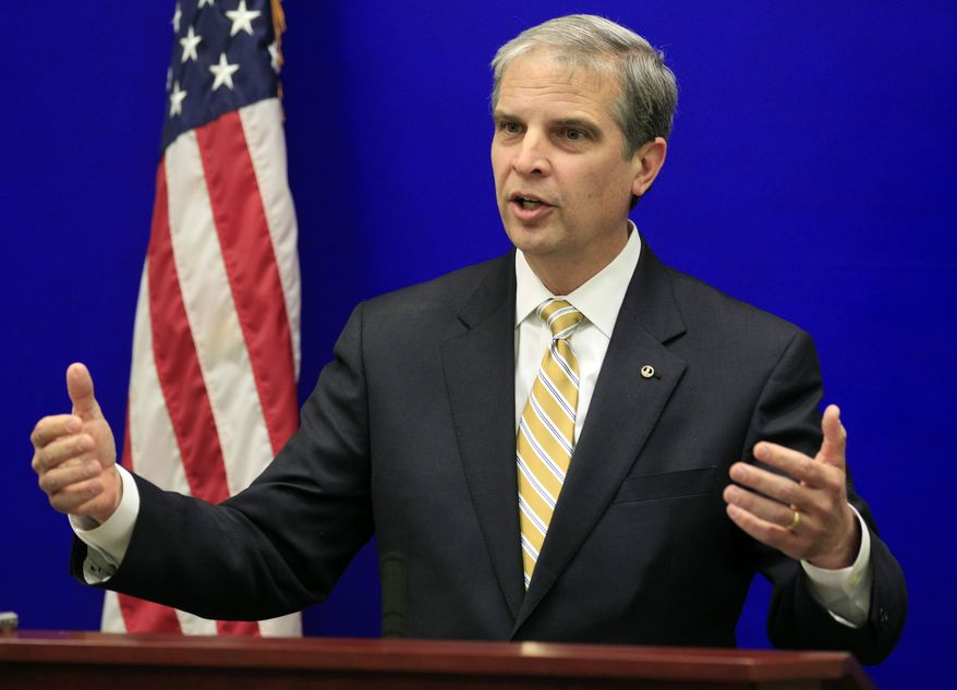 FILE - In this Nov. 13, 2013 file photo, State Sen. Mark Obenshain, R-Harrisonburg, Republican candidate for Attorney General,  gestures during a new conference at the Capitol Wednesday, Nov. 13, 2013, in Richmond, Va.  The closest statewide race in modern Virginia political history is unlikely to end Monday, Nov. 25,  when the State Board of Elections certifies the votes for attorney general and other contests in the Nov. 5 election. The State Board of Elections puts Democrat Mark Herring with a 165-vote edge over Obenshain out 2.2 million ballots cast for attorney general. While he hasn't said so, Obenshain has signaled he will seek a recount, and he could press the issue to the General Assembly if he wants to take it to the limits of the law.  (AP Photo/Steve Helber)