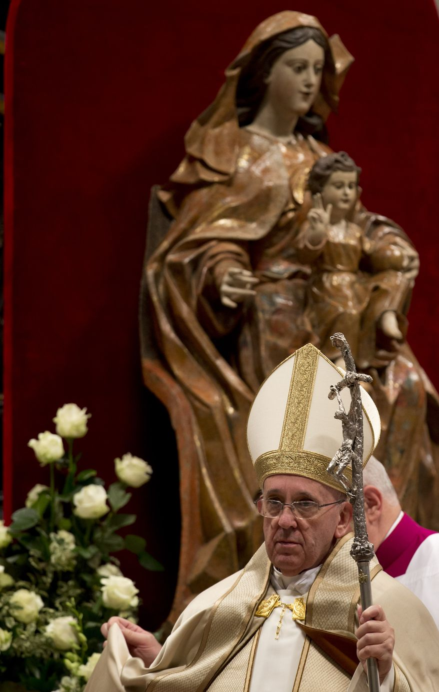Pope Francis leaves St. Peter's Basilica at the Vatican to celebrate the rite of acceptance and meeting with the catechumens, Saturday, Nov. 23, 2013. (AP Photo/Andrew Medichini)