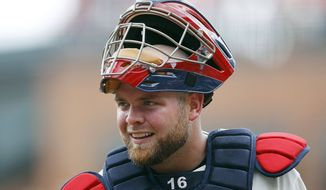 FILE - In this July 15, 2012, file photo, Atlanta Braves catcher Brian McCann looks on during a baseball game against the New York Mets in Atlanta. A person familiar with the negotiations tells The Associated Press that free-agent McCann and the New York Yankees are about to close a five-year deal for about $85 million. The person spoke Saturday night, Nov. 23, 2013, on condition of anonymity because the deal was not complete. (AP Photo/John Bazemore, File)