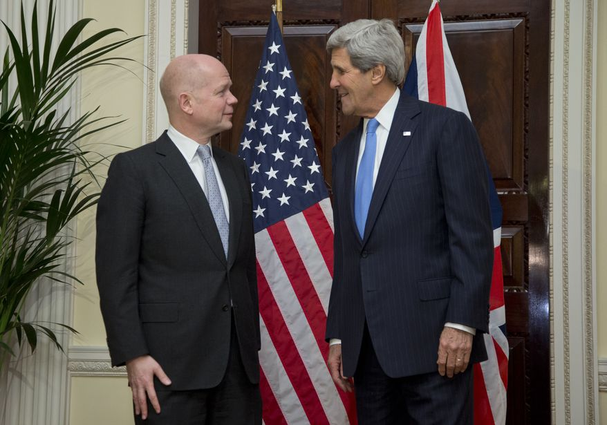 U.S. Secretary of State John Kerry, right, talks with British Foreign Secretary William Hague, at Winfield House, the residence of the U.S. Ambassador to Britain, in London, Sunday, Nov. 24, 2013. Kerry, arrived in the U.K. following two days of negotiations in Geneva to forge an agreement between the United States and five other nations with Iran over its nuclear programme. (AP Photo/Carolyn Kaster, Pool)
