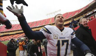 San Diego Chargers quarterback Philip Rivers (17) is congratulated by fans following an NFL football game against the Kansas City Chiefs in Kansas City, Mo., Sunday, Nov. 24, 2013. The Chargers won 41-38. (AP Photo/Ed Zurga)