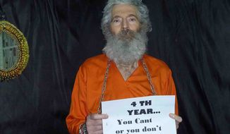 ** FILE ** This undated handout photo provided by the family of Robert Levinson, shows retired-FBI agent Robert Levinson who went missing on the Iranian island of Kish in March 2007 and Levinson's family received these photographs of him in April 2011. (AP Photo/Levinson Family)