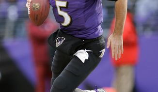 Baltimore Ravens quarterback Joe Flacco scrambles with the ball during the first half of an NFL football game against the New York Jets in Baltimore, Md., Sunday, Nov. 24, 2013. (AP Photo/Patrick Semansky)