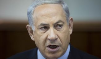 Israeli Prime Minister Benjamin Netanyahu attends the weekly Cabinet meeting at his office in Jerusalem on Sunday, Nov. 24, 2013. (AP Photo/Abir Sultan, Pool)