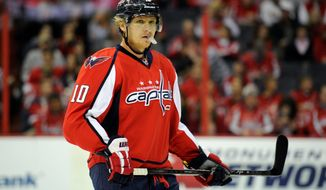 Washington Capitals left wing Martin Erat (10), of the Czech Republic, looks on during the first period an NHL hockey game against the Columbus Blue Jackets, Saturday, Oct. 19, 2013, in Washington. (AP Photo/Nick Wass)