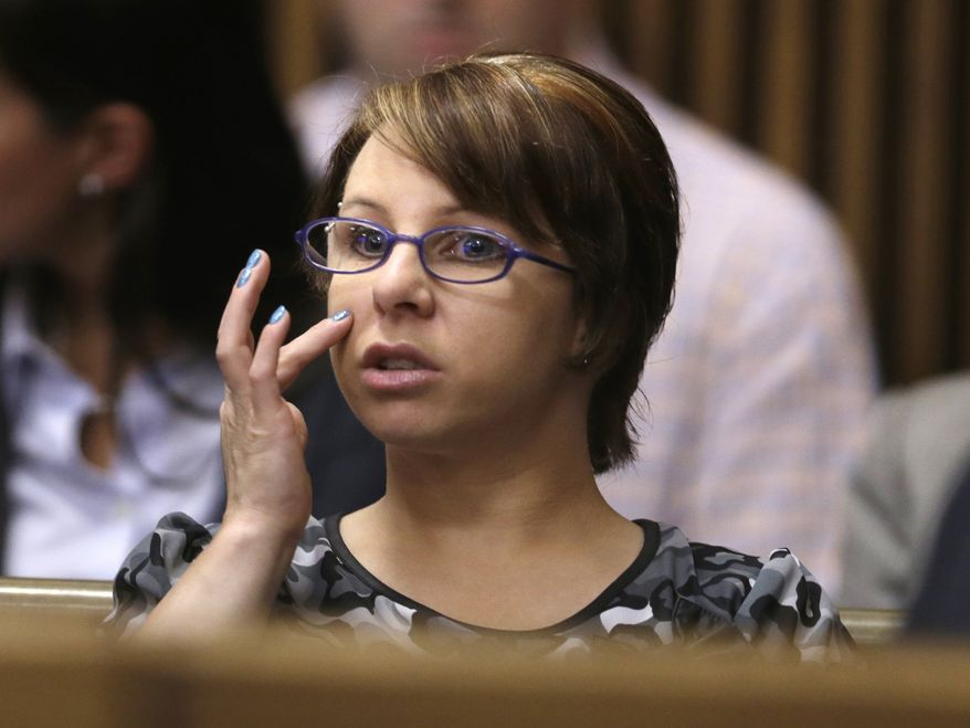 ** FILE ** In a Thursday, Aug. 1, 2013, file photo, Michelle Knight sits in the courtroom during a break in the sentencing phase for Ariel Castro, in Cleveland. Knight's memoir is scheduled to come out next spring, publisher Weinstein Books announced Monday, Nov. 25, 2013. The book is currently untitled and will be co-written by Michelle Burford, who worked on Olympic gold medalist Gabby Douglas' memoir. (AP Photo/Tony Dejak, File)