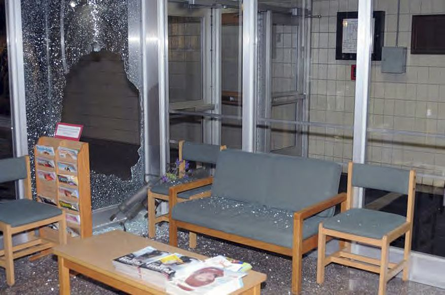 """This image contained in the """"Appendix to Report on the Shootings at Sandy Hook Elementary School and 36 Yogananda St., Newtown, Connecticut On December 14, 2012"""" and released Monday, Nov. 25, 2013, by the Danbury, Conn., State's Attorney shows a scene inside the entrance to Sandy Hook Elementary School in Newtown, Conn. Adam Lanza opened fire inside the school killing 20 first-graders and six educators before killing himself as police arrived. (AP Photo/Office of the Connecticut State's Attorney Judicial District of Danbury)"""