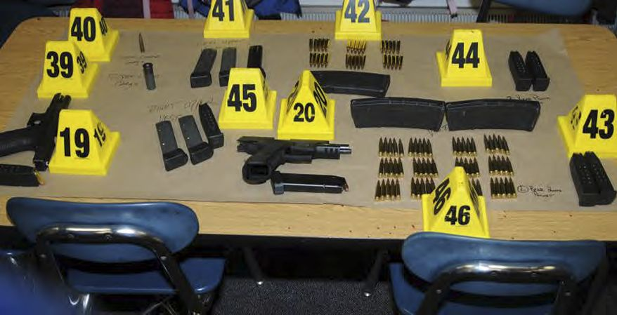 "This image contained in the ""Appendix to Report on the Shootings at Sandy Hook Elementary School and 36 Yogananda St., Newtown, Connecticut On December 14, 2012"" and released Monday, Nov. 25, 2013, by the Danbury, Conn., State's Attorney shows weapons and ammunition found at Sandy Hook Elementary School in Newtown, Conn. Adam Lanza opened fire inside the school killing 20 first-graders and six educators before killing himself as police arrived. (AP Photo/Office of the Connecticut State's Attorney Judicial District of Danbury)"