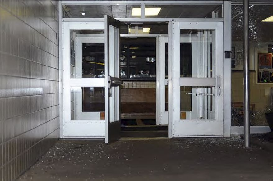 "This image contained in the ""Appendix to Report on the Shootings at Sandy Hook Elementary School and 36 Yogananda St., Newtown, Connecticut On December 14, 2012"" and released Monday, Nov. 25, 2013, by the Danbury, Conn., State's Attorney shows a scene outside the entrance to Sandy Hook Elementary School in Newtown, Conn. Adam Lanza opened fire inside the school killing 20 first-graders and six educators before killing himself as police arrived. (AP Photo/Office of the Connecticut State's Attorney Judicial District of Danbury)"
