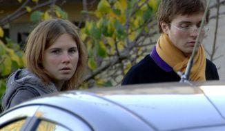 ** FILE ** American exchange student Amanda Knox (left) and Raffaele Sollecito, her Italian boyfriend, stand outside the rented house in Perugia, Italy, where 21-year-old British student Meredith Kercher was found dead on Friday, Nov. 2, 2007. (AP Photo/Stefano Medici)