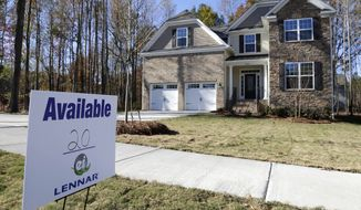 A home in Matthews, N.C., is advertised for sale on Thursday, Nov. 14, 2013. (AP Photo/Chuck Burton)
