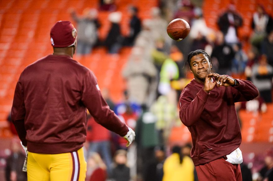 Washington Redskins tight end Fred Davis (83), left, and Washington Redskins quarterback Robert Griffin III (10) warm up before the Washington Redskins play the San Francisco 49ers in Monday Night Football at FedExField, Landover, Md., Monday, November 25, 2013. (Andrew Harnik/The Washington Times)
