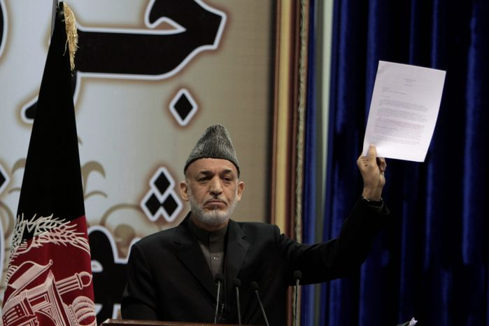 Afghan President Hamid Karzai is holding off on signing a security deal with the U.S., ignoring the recommendation of Afghan leaders. (associated press)
