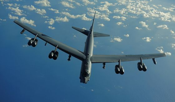 A U.S. Air Force B-52 Stratofortress from the 20th Expeditionary Bomb Squadron, Barksdale AFB, La., flies a mission in support of Rim of the Pacific (RIMPAC) 2010. RIMPAC includes more than 14 nations, 32 ships, five submarines, more than 170 aircraft and more than 20,000 Soldiers, Sailors, Marines and Airmen, July 10, 2010. RIMPAC enhances cooperation between partnering nations and practices our ability to plan, communicate, and execute operations. (U.S. Air Force photo by Tech. Sgt. Jacob N. Bailey)