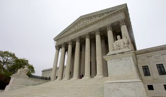 """The United States Supreme Court is seen Saturday, March 24, 2012, in Washington, two days before the court will begin hearing arguments Monday on the constitutionality of President Barack Obama's health care overhaul, the Patient Protection and Affordable Care Act, derisively labeled """"Obamacare"""" by its opponents. (AP Photo/Haraz N. Ghanbari)"""
