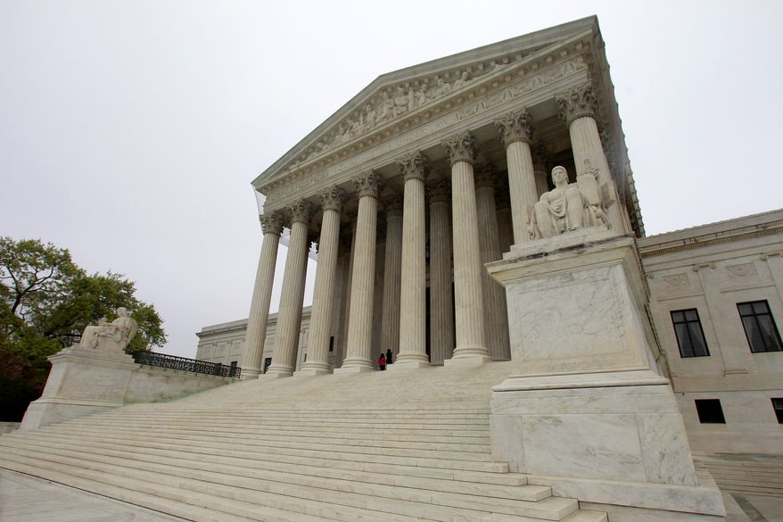 "The United States Supreme Court is seen Saturday, March 24, 2012, in Washington, two days before the court will begin hearing arguments Monday on the constitutionality of President Barack Obama's health care overhaul, the Patient Protection and Affordable Care Act, derisively labeled ""Obamacare"" by its opponents. (AP Photo/Haraz N. Ghanbari)"