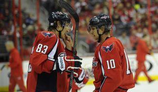 Washington Capitals left wing Martin Erat (10), of the Czech Republic, talks with Jay Beagle during the first period an NHL hockey game against the Colorado Avalanche, Saturday, Oct. 12, 2013, in Washington. (AP Photo/Nick Wass)