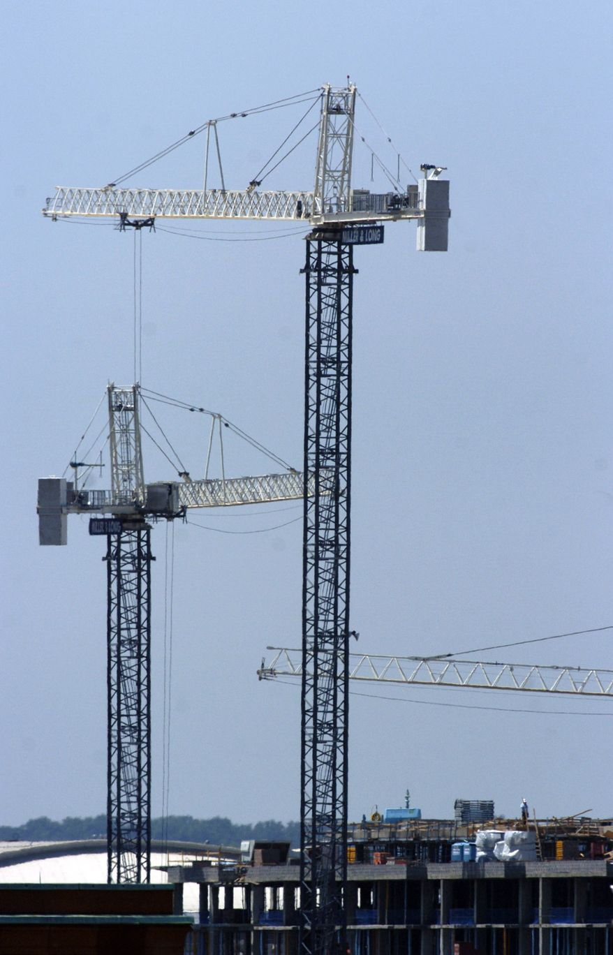 Construction cranes dot the horizon in NW Washington D.C., Tuesday, May 29, 2007. (Allison Shelley / The Washington Times)