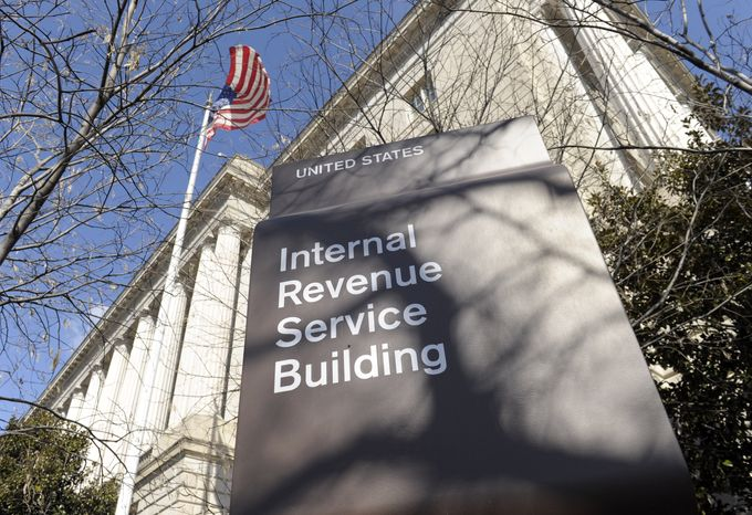 """FILE - In this Friday, March 22, 2013, file photo, the exterior of the Internal Revenue Service building in Washington, is shown. The Obama administration, on Tuesday, Nov. 26, 2013, launched a bid to rein in the use of tax-exempt groups for political campaigning. The effort is an attempt to reduce the role of loosely regulated big-money political outfits like GOP political guru Karl Rove's Crossroads GPS and the pro-Obama Priorities USA. The Internal Revenue Service and the Treasury Department said they want to prohibit such groups from using """"candidate-related political activity"""" like running ads, registering voters or distributing campaign literature as activities that qualify them to be tax-exempt """"social welfare"""" organizations. (AP Photo/Susan Walsh, File)"""