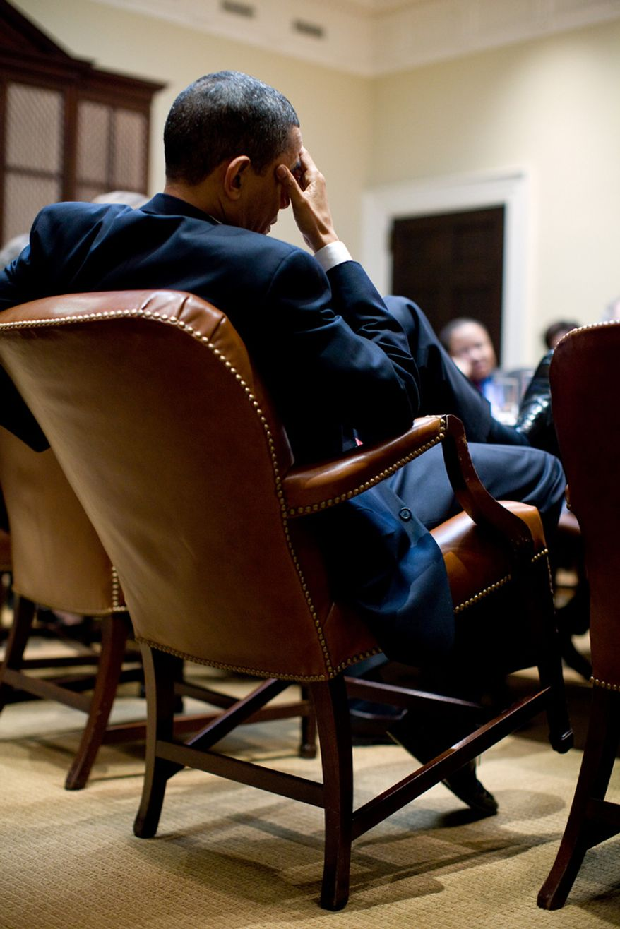 ** FILE ** President Obama attends a meeting in the Roosevelt Room of the White House. (Official White House photo by Pete Souza)
