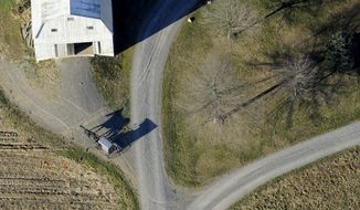 ** FILE ** An Amish buggy heads down a driveway to a farm near Washingtonville, Pa., on Wednesday, Nov. 20, 2013. (AP Photo/Bloomsburg Press Enterprise, Jimmy May)