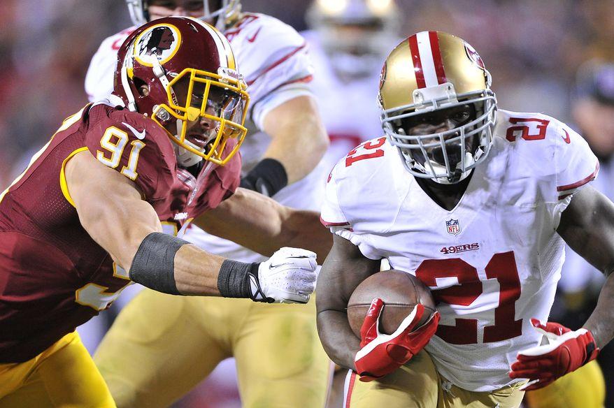 Washington Redskins outside linebacker Ryan Kerrigan (91) can't grab San Francisco 49ers running back Frank Gore (21) at FedExField, Landover, Md., Novermber 25, 2013. (Preston Keres/Special for The Washington Times)