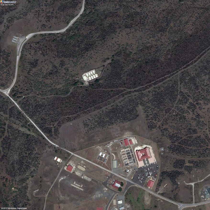 The secret CIA facility known as Penny Lane is shown in the upper middle in white in a 2010 satellite photo of the Naval Station Guantanamo Bay in Cuba. (AP Photo/TerraServer.com and DigitalGlobe)