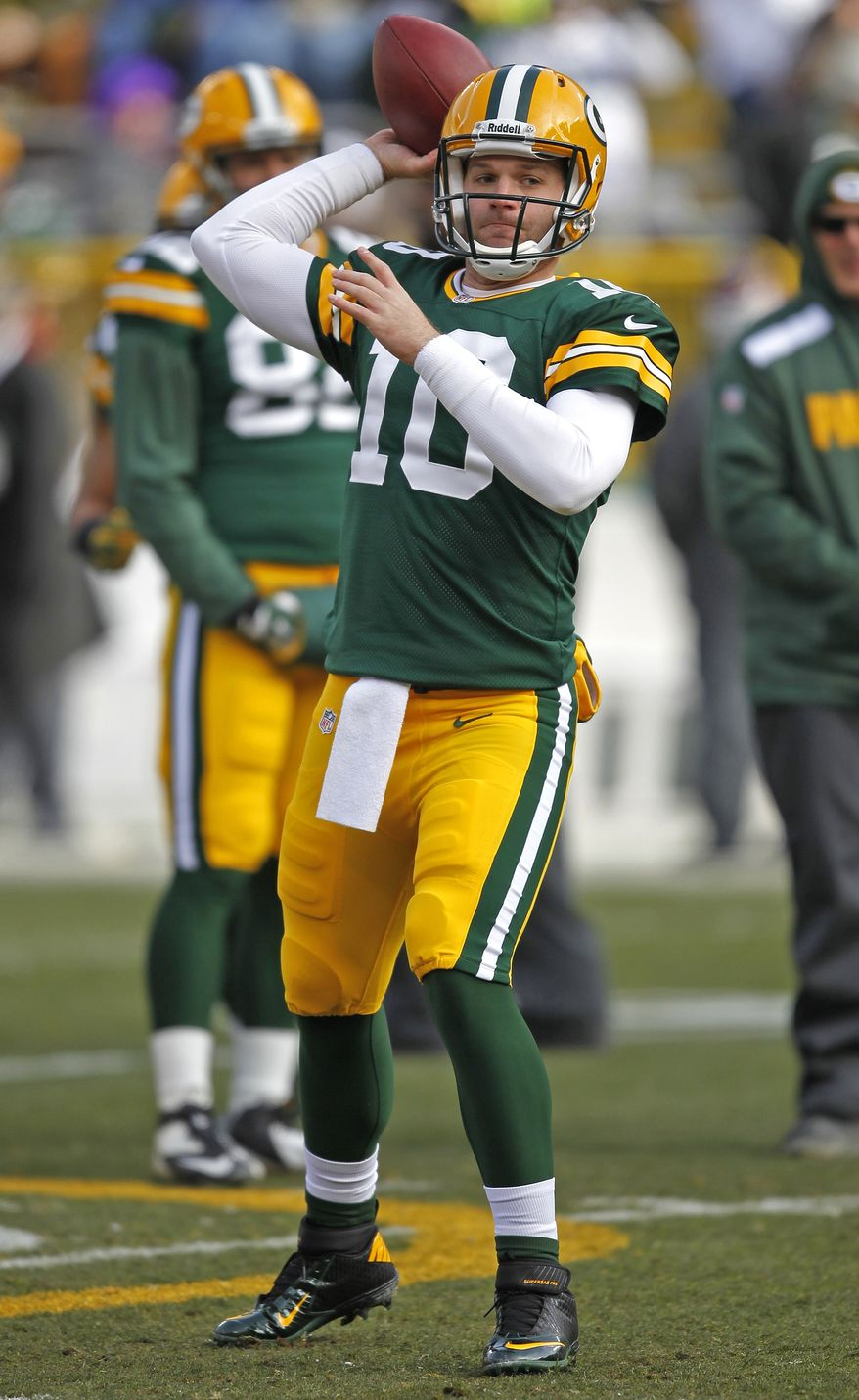 Green Bay Packers quarterback Matt Flynn throws passes in warm ups prior to an NFL football game against the Minnesota Vikings Sunday, Nov. 24, 2013, in Green Bay, Wis. (AP Photo/Matt Ludtke)