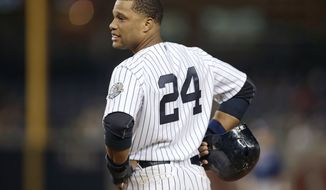FILE - In this Sept. 25, 2013, file photo, New York Yankees' Robinson Cano looks toward the dugout during the eighth inning of the Yankees' 8-3 loss to the Tampa Bay Rays in a baseball game in New York. Representatives for  the free-agent met Tuesday, Nov. 26, 2013, with the Yankees, and the gap between the sides remains wide, according to a person familiar with the negotiations.  The person spoke to The Associated Press on condition of anonymity because no statements were authorized. The person adds the sides may meet again Wednesday.  (AP Photo/Kathy Willens, File)