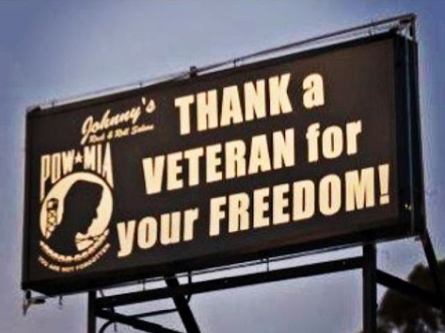 Two bar owners in Huntington Beach, Calif., said they are facing fines by the city for a billboard perched atop their establishment that displays a pro-military message.