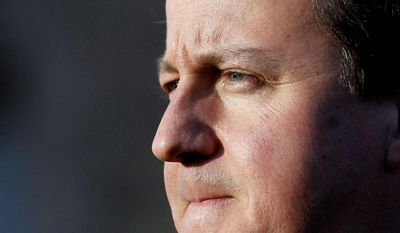 **FILE** British Prime Minister David Cameron pauses during a press conference at Stormont Castle in Belfast, Northern Ireland, on Nov. 20, 2012. (Associated Press)