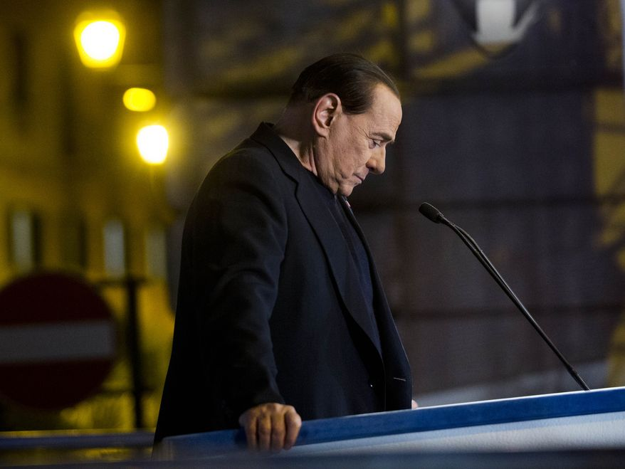 """Italian former Premier Silvio Berlusconi pauses during a rally in Rome, Wednesday, Nov. 27, 2013. Berlusconi appeared Wednesday before cheering supporters outside his Roman palazzo, where he accused prosecutors of conducting """"political persecution"""" against him over the past 20 years. (AP Photo/Alessandra Tarantino)"""