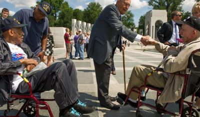 Rep. John D. Dingell (center), Michigan Democrat, speaks with retired Navy Seaman McKenley Morgan (left) of Flint, Mich.; his son Bruce Morgan (second from left) of Virginia Beach; and retired Army Sgt. Stanley Kaczor (right) of Woodhaven, Mich., at the World War II Memorial in Washington on Wednesday, June 6, 2012, the 68th anniversary of D-Day, as part of the Honor Flights program, which flies U.S. veterans to Washington to visit the memorials on the National Mall. Both the elder Mr. Morgan and Mr. Kaczor are World War II veterans, as is Mr. Dingell. (Andrew Harnik/The Washington Times)