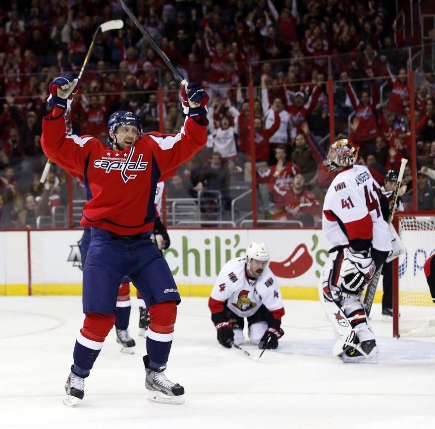 Washington Capitals right wing Eric Fehr (16) celebrates his goal past Ottawa Senators goalie Craig Anderson (41) in the first period of an NHL hockey game, Wednesday, Nov. 27, 2013, in Washington. (AP Photo/Alex Brandon)