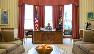 President Barack Obama makes Thanksgiving Day phone calls to selected U.S. troops, from the Oval Office, Nov. 28, 2013, 2013. 