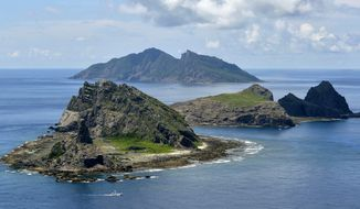 Minamikojima (foreground), Kitakojima, (middle right) and Uotsuri (background) are tiny islands in the East China Sea, called Senkaku in Japanese and Diaoyu in Chinese. (AP Photo/Kyodo News, File)