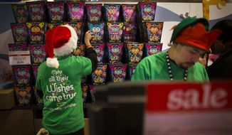 Employees stock Furby dolls behind a register at the Times Square Toys R' Us, Thursday, Nov. 28, 2013, in New York. Instead of waiting for Black Friday, which is typically the year's biggest shopping day, more than a dozen major retailers are opening on Thanksgiving this year. (AP Photo/John Minchillo)