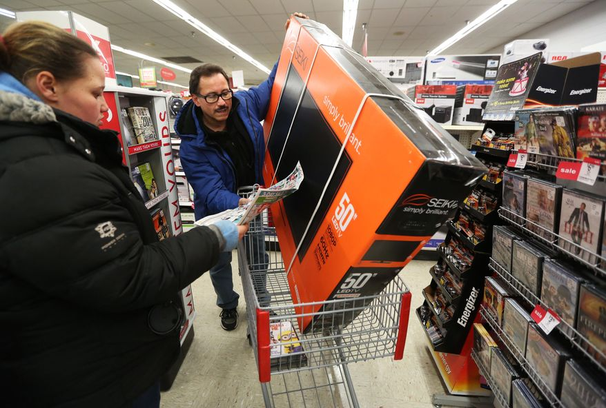 IMAGE DISTRIBUTED FOR KMART - Luis Torres and his daughter Stephanie, from Chicago, search for more deals after picking up a 50 inch television during the doorbuster sales at Kmart's Addison St. store on Thursday, Nov. 28, 2013 in Chicago, Ill. Kmart was the first major retailer to open it's doors for pre-Black Friday shopping on Thanksgiving Day at 6am. (John Konstantaras/AP Images for Kmart)