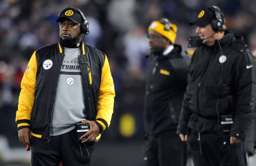 Pittsburgh Steelers head coach Mike Tomlin, left, watches from the sideline in the second half of an NFL football game against the Baltimore Ravens, Thursday, Nov. 28, 2013, in Baltimore. (AP Photo/Gail Burton)