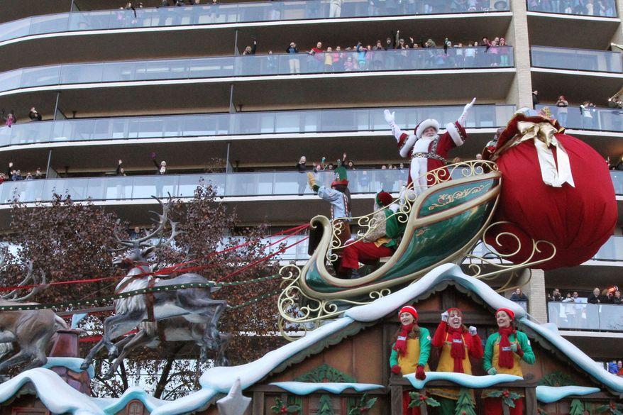 The Santa's Sleigh float makes it way across New York's Central Park South during the Macy's Thanksgiving Day Parade Thursday Nov. 28, 2013. (AP Photo/Tina Fineberg)