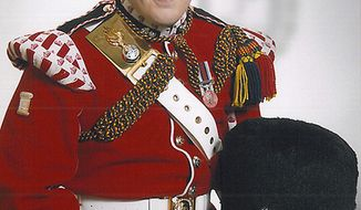 ** FILE ** This undated file image released on Thursday May 23, 2013, by the British Ministry of Defence, shows Lee Rigby, who was attacked and killed by two men in the Woolwich area of London on May 23, 2013. A prosecutor outlined the chilling tactics used to nearly decapitate an unarmed British soldier on a London street, as two men went on trial Friday Nov. 29, 2013 in connection with the suspected extremist attack. (AP Photo/MOD, File)